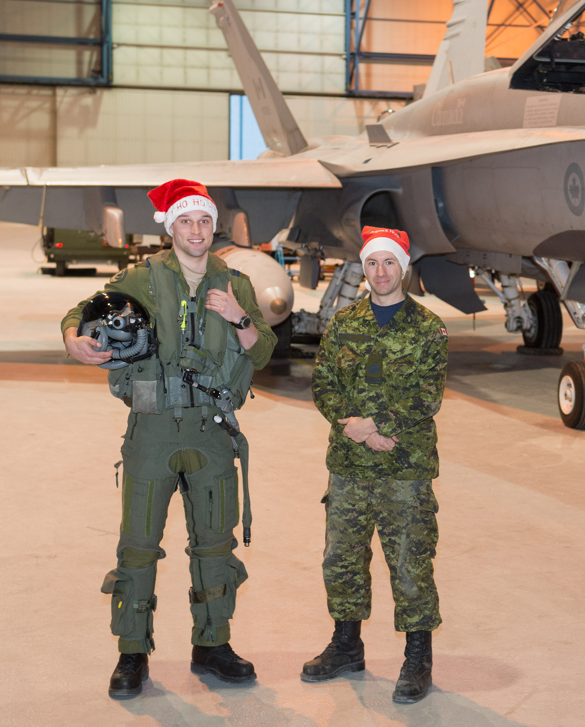 At 3 Wing Bagotville, Quebec, CF-188 Hornet pilot Captain Pierre-David Boivin, along with maintainer Master Corporal Marc-André David, are ready to escort Santa on his journey through North American airspace on December 24, 2017. Both are members of 433 Tactical Fighter Squadron. PHOTO: Leading Seaman Alex Roy, BN01-2015-0747-001