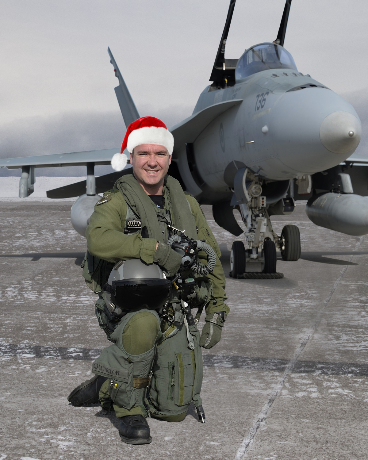 CF-188 Hornet pilot Captain Pierre-Claude Quirion of 433 Tactical Fighter Squadron at 3 Wing Bagotville, Quebec, is ready to escort Santa Claus through North American airspace on December 24, 2017. PHOTO: Corporal Vlassova Elena, CK2013-0253-04