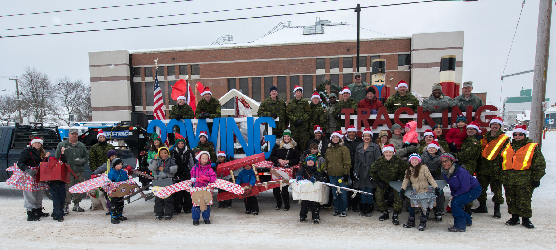 Canadian and American service personnel and their families at 22 Wing North Bay, Ontario, gather in from the parade float that was part of their entry in the city's annual Santa Claus parade on November 19, 2017. This was the first year that 22 Wing participated in the annual parade. PHOTO: Corporal Joseph Morin, NB02-2017-0271-022