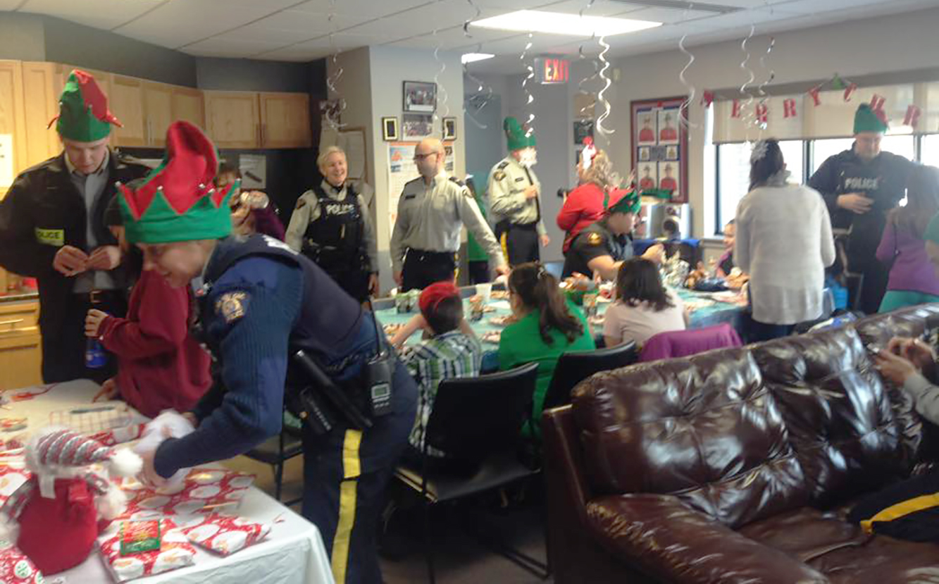The Happy Valley-Goose Bay local Royal Canadian Mounted Police Detachment is buzzing as local young people, volunteers and elves gather during Shop with a Cop day, on December 3, 2017. PHOTO: https://www.facebook.com/hvgbCrimePrevention/