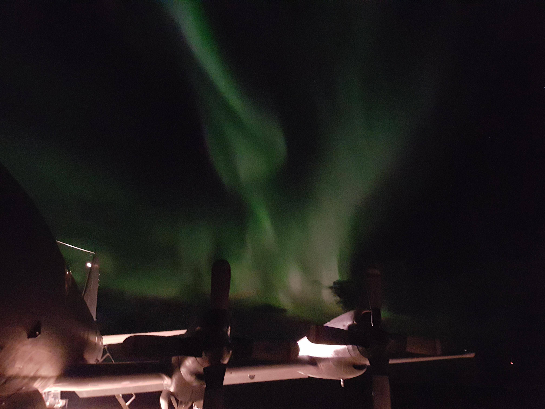 A 415 Long Range Patrol Force Development Squadron CP-140 Aurora aircraft chills under the aurora borealis while deployed on an exercise to Andøya Air Station in Norway. PHOTO: Submitted