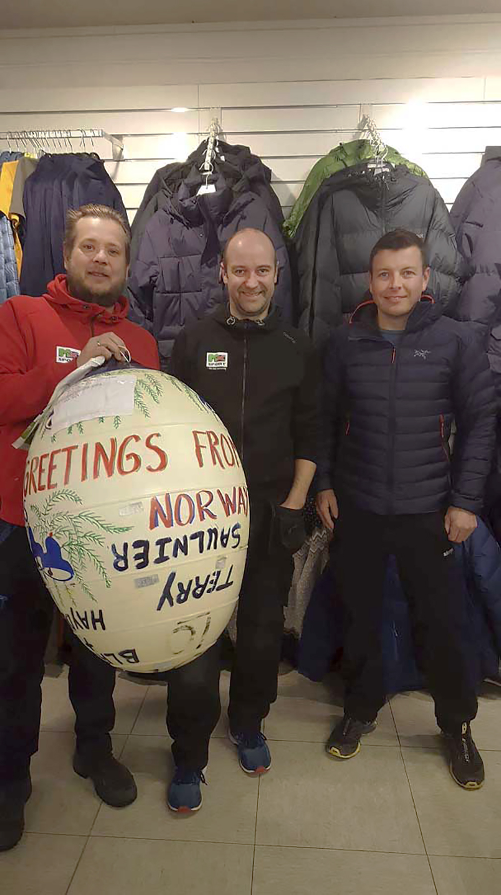 From left are Lars Framvik, who found the fishing buoy's Nova Scotian owner, Terry Saulnier, on Facebook; Preben Olsen, who found the buoy on the shore of Norway; and Warrant Officer Martin Fiset of 415 Long Range Patrol Force Development Squadron. Warrant Officer Fiset picked up the buoy from Mr. Framvik and Mr. Olsen in Andenes, Norway, so it could be brought home to Mr. Saulnier after its long journey. PHOTO: Submitted