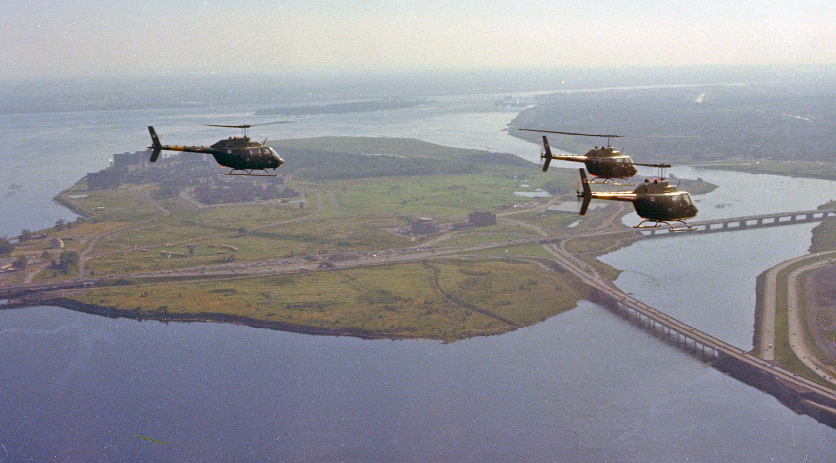 Three 427 Squadron CH-136 Kiowa helicopters from Petawawa, Ontario, fly over Nun's Island in Montreal during Exercise Power Play in August 1974. 427 Squadron began operating CH-136 Kiowa light observation helicopters in the 1970s. PHOTO: DND Archives, IMC74-123