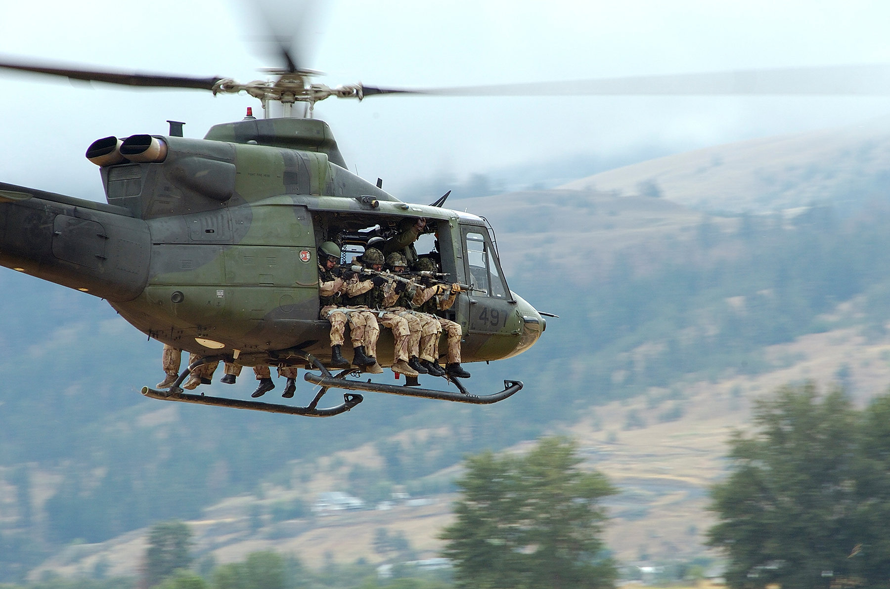 Troops from the Canadian Special Operations Regiment return to the forward operating base aboard a CH-146 Griffon helicopter from 427 Special Operations Aviation Squadron on July 20, 2006, during a training exercise near Kamloops, British Columbia. PHOTO: Sergeant Donald Clark, LW2006-5223d