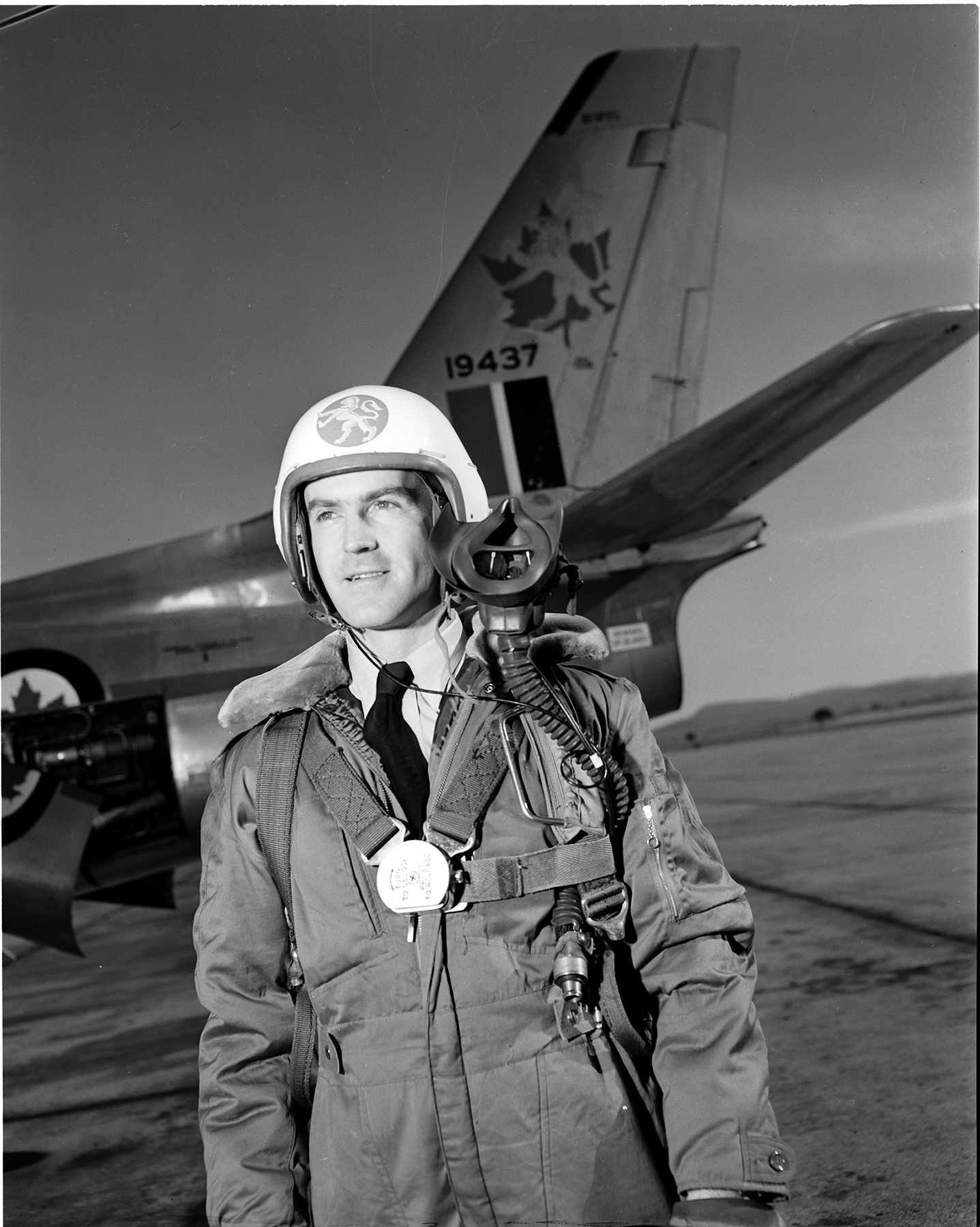 On February 2, 1953, Flying Officer J.B. Mullin of Montreal stands to the side of his CF-104 Starfighter supersonic fighter at St. Hubert, Québec. Used primarily as a ground attack, low-level strike and reconnaissance aircraft, the Starfighter served 427 Squadron and the RCAF beginning in the early-1960s, replacing its predecessor, the F-86 Sabre. PHOTO: DND Archives, PL-56148
