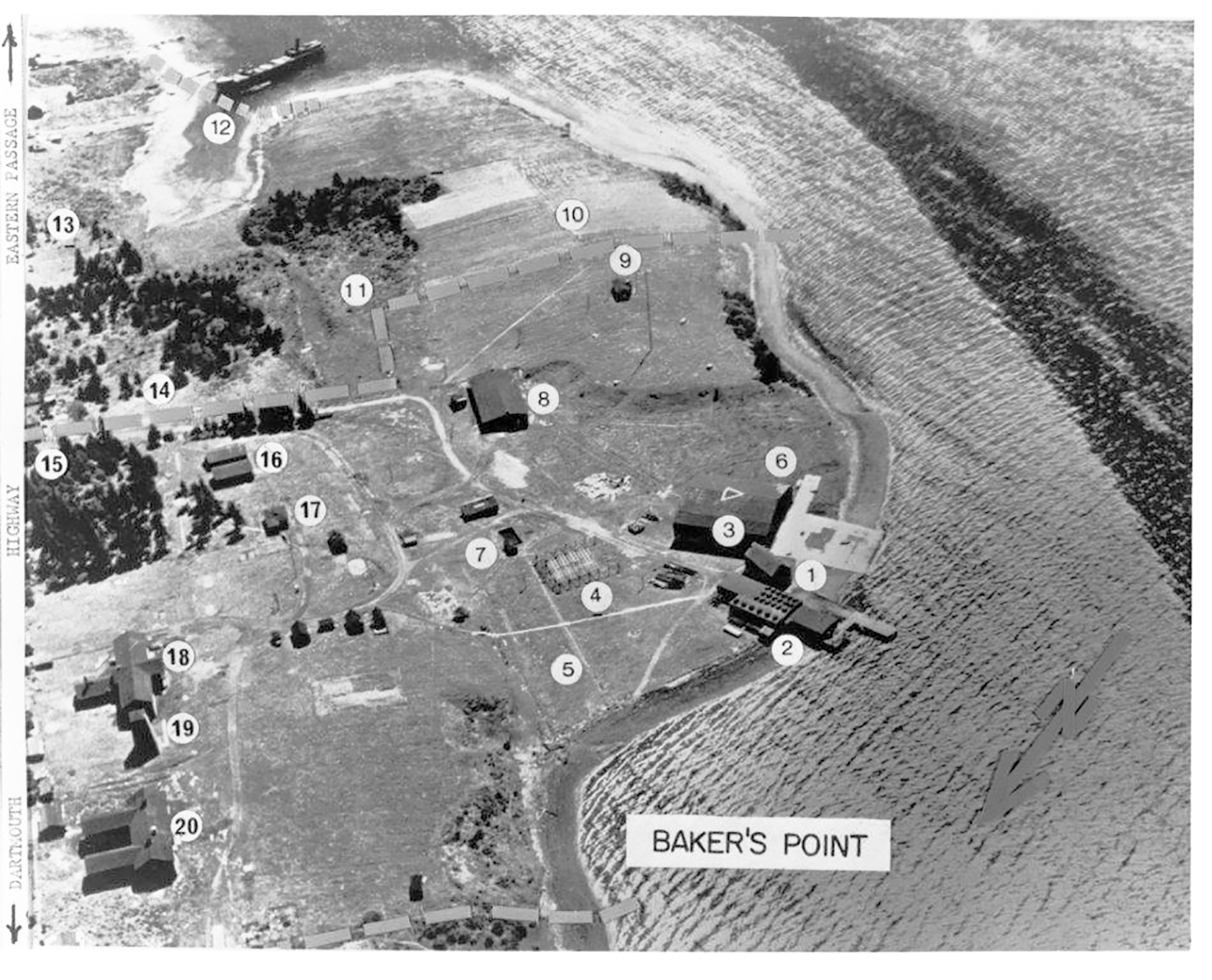 An undated aerial view of the facilities on the small promontory, Baker Point, in Halifax Harbour's Eastern Passage, which became U.S. Naval Air Station Halifax. LEGEND: 1) Old fish plant; dilapidated by 1918. 2) Fish plant buildings converted to aircraft repair shops. 3) Prefabricated hangar erected by U.S. Naval Air Station under Lieutenant Byrd in 1918. 4) Framework for canvas-covered kite balloon hangar. 5) Z hangar site, Second World War; also the site of the Shearwater Yacht Club. 6) X hangar site, Second World War; floor converted to tennis courts. 7) Outdoor reservoir and pump house for firefighting. 8) Administration building; 9) Bennett house, converted to air traffic control building. In 1942, E Block was erected on this site, to house RCAF personnel, converted to 406 Squadron technical training facility and Fleet Diving Unit offices. 10) A long sloping hill cut down to fill areas 1 and 12. 11) Swamp and pond filled circa 1938-40. 12) Bay filled with earth from site 10, which covers one steel and two wooden ship hulls. 13) Site of 4 Building. 14) Prior to government acquisition, a piggery; later site of motor transport garages and gas pump. 15) 1940-48 site of steel water tower; later site of Bank of Montreal and Baden Powell Center. 16) Prior to government acquisition, implement sheds; later site of motor transport garages. 17) Murray house; later, Lieutenant Byrd's cottage. The Murray family owned most of the land that is now Shearwater. 18) Canadian-built barracks for use by U.S. Naval Air Station personnel. 19) Artesian well-fed wooden water tower. By 1938, the water had been declared unusable. 20) Canadian-built barracks for use by U.S. Naval Air Station personnel. PHOTO: DND Archives, CN-3961; LEGEND: Shearwater Aviation Museum