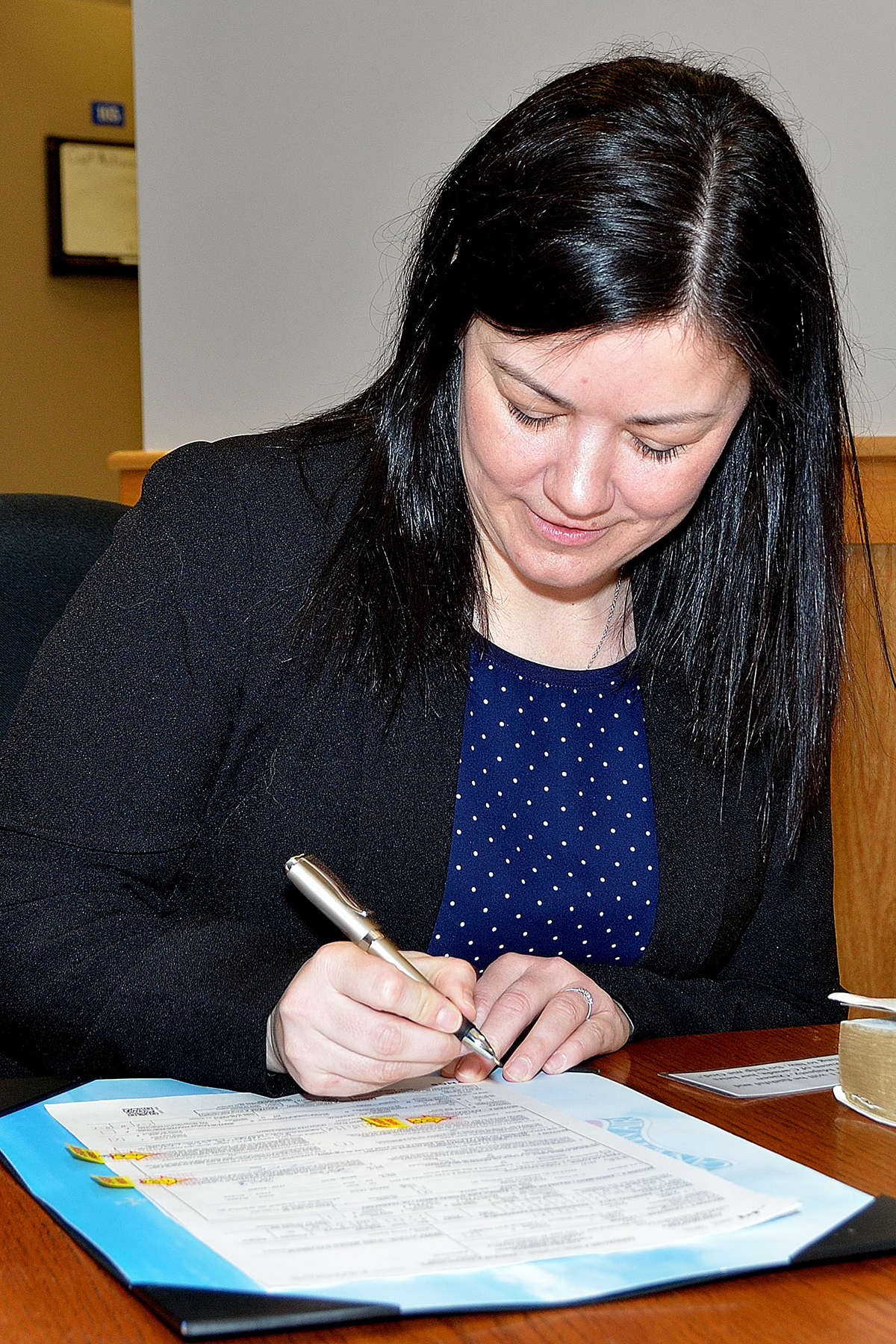 Performing one of her final acts as a civilian, Lorna Clark signs her enrollment paperwork during her swearing-in ceremony on January 19, 2018, becoming Aviator Lorna Clark, a new member of the Royal Canadian Air Reserve at 5 Wing Goose Bay, Newfoundland and Labrador. PHOTO: Master Corporal Krista Blizzard, GB2018-01-002