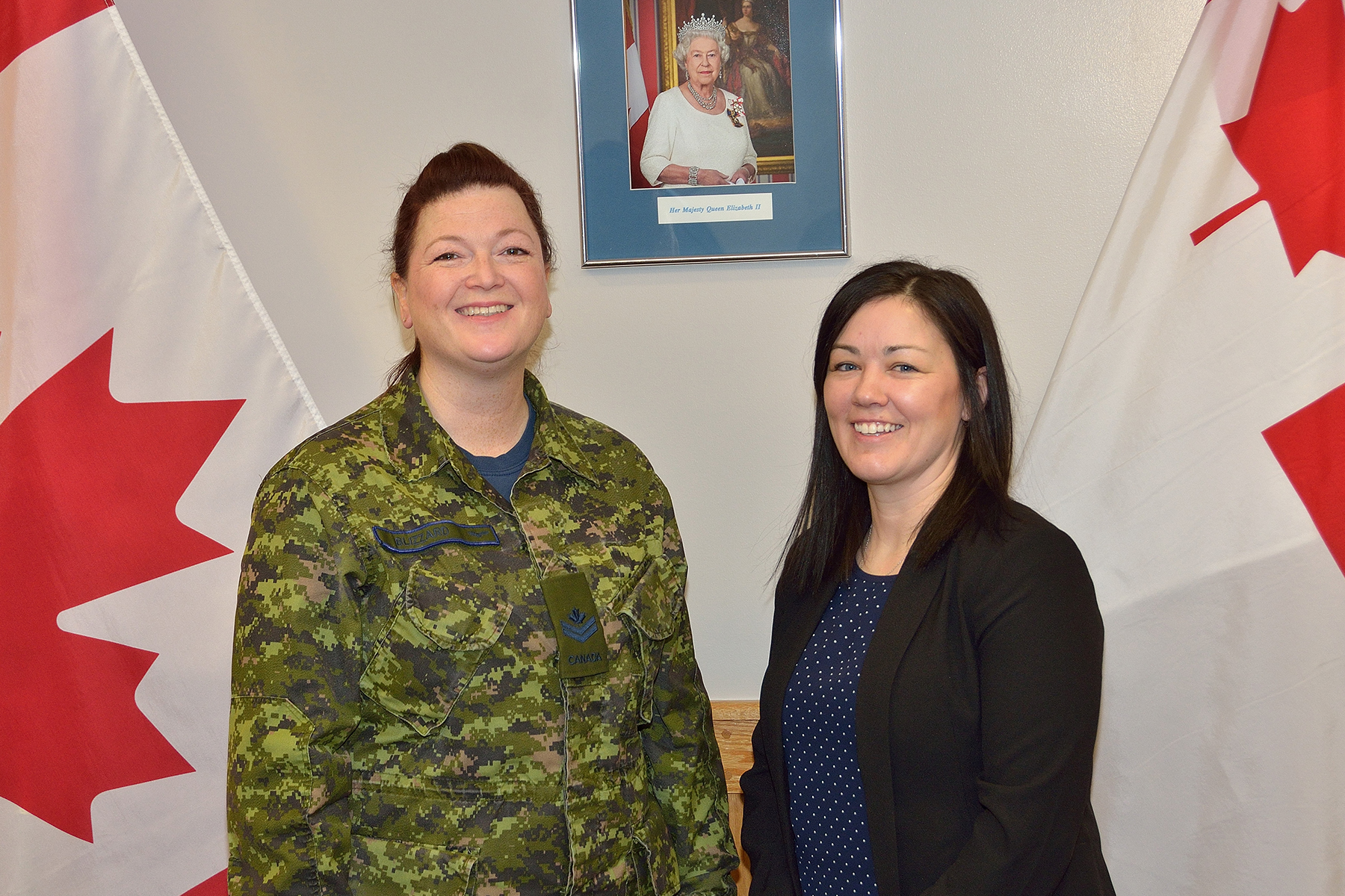 During her January 19, 2018, swearing-in ceremony, Aviator Lorna Clark (right) stands with her RCAF Reserve recruiter, Master Corporal Krista Blizzard, at 5 Wing Goose Bay, Newfoundland and Labrador. They are the first and second RCAF Reserve members from Happy Valley-Goose Bay in Labrador. PHOTO: DND, GB2018-01-012