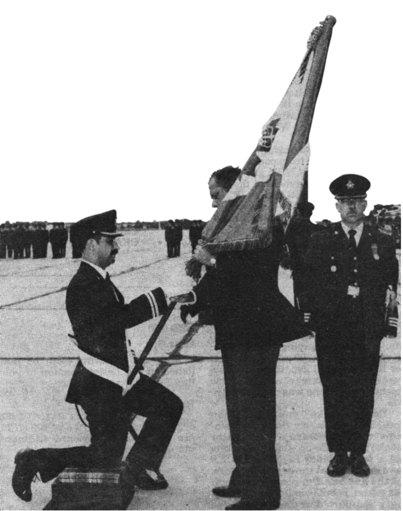 Following the unification of the Canadian Armed Forces, the Air Force received its second stand of Colours, reflecting its identity as Air Command, on July 31, 1982, in Winnipeg, Manitoba. Here, Governor General Ed Schreyer presents the Queen's Colour. PHOTO: DND