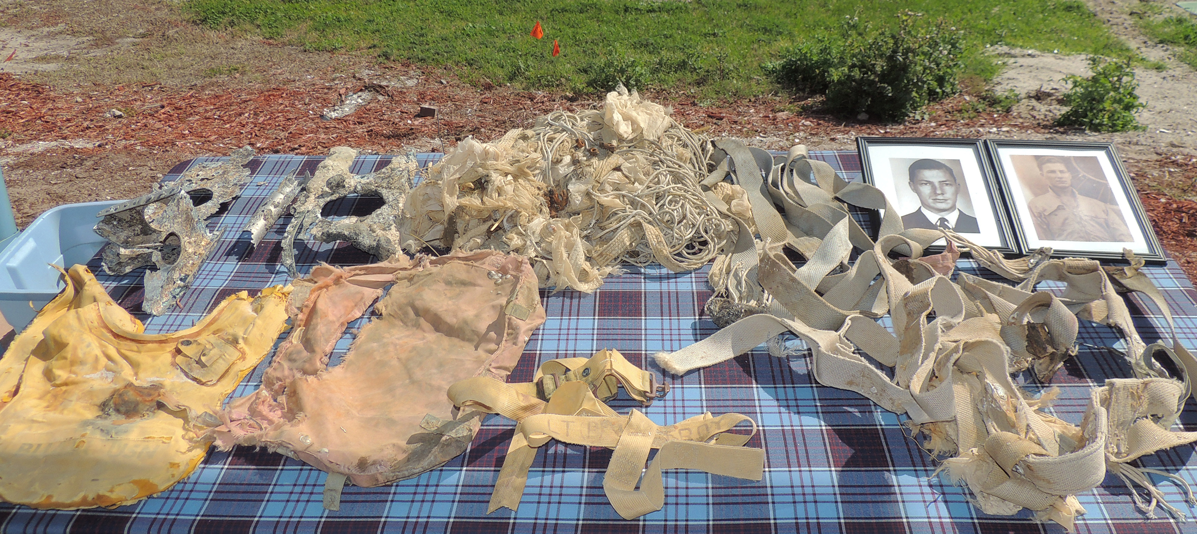 The artifacts recovered from a Jacksonville, Florida, beach last autumn include a parachute, parachute cover and harness, an inflatable life jacket and pieces of the Banshee Lieutenant Barry Troy was flying when he crashed on February 25, 1958. In the centre foreground are straps from the life jacket with Lieutenant Troy's name written on them, which enabled the park ranger who found them and the police officer who took custody of the artifacts to identify to whom they belonged. PHOTO: Joanna Calder, RCAF public affairs