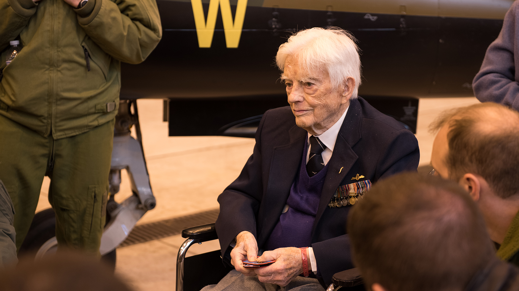 Royal Canadian Air Force Squadron Leader (retired) George Sweanor, 98, one of the founding members of No. 419 squadron, talks with members of 419 Tactical Fighter (Training) Squadron at Colorado Springs, Colorado, on February 23, 2018, following the unit's training mission in El Centro, California. PHOTO: NORAD/USNORTHCOM Public Affairs