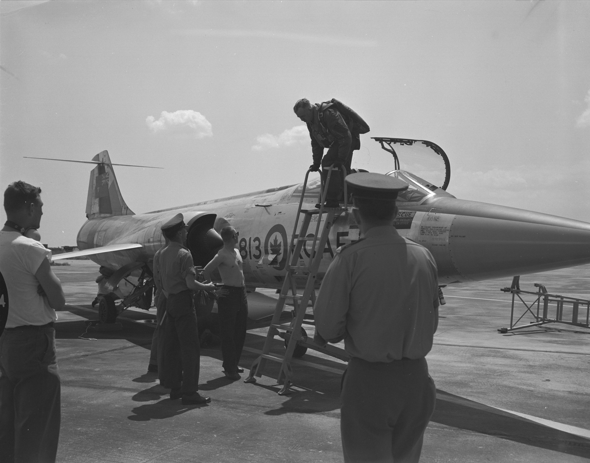 "The original caption of this photo reads: ""The first of many CF-104 Starfighter jet aircraft that would arrive at Decimomannu, Sardinia, before the Canadians would leave this tri-nation NATO airbase in July 1970. Prior to this arrival on May 6, 1963, Canadian F-86 Sabres and CF-100 Canucks were common sights here as Canadian pilots, from NATO-assigned 1 Air Division bases in France and Germany, came to practice bombing or gunnery at the nearby Capo della Frasca ranges."" PHOTO: DND Archives, AW296-5"