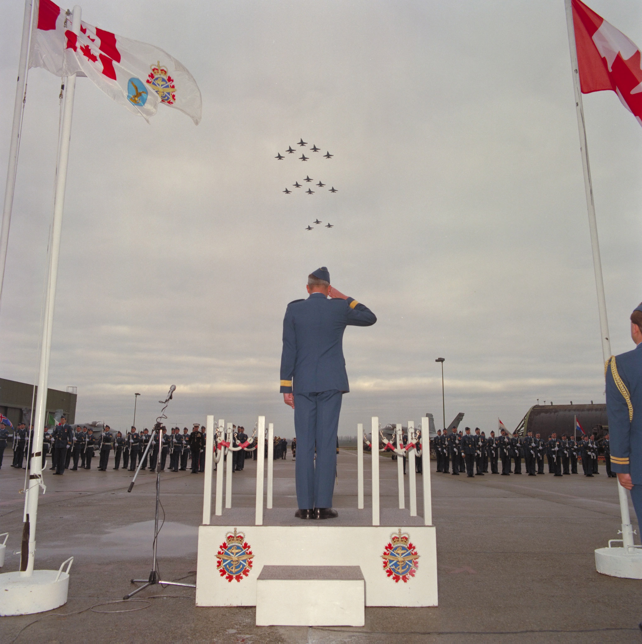 Reviewing officer Lieutenant-General David Huddleston, commander of Air Command, salutes during the closing of No. 4 (Fighter) Wing, Canadian Forces Base Baden Soellingen, in 1992. PHOTO: DND Archives, BAC92-459-14