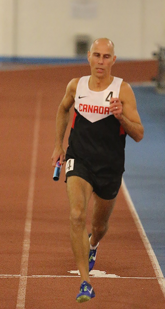 Chief Warrant Officer Claude Faucher, from Canadian Forces Base Borden, Ontario, runs his leg of the 4 X 400m relay held in Toronto, Ontario, on March 10 and 11, 2018; he and his teammates set a new Canadian record with a time of 3:50.24. PHOTO: John MacMillan
