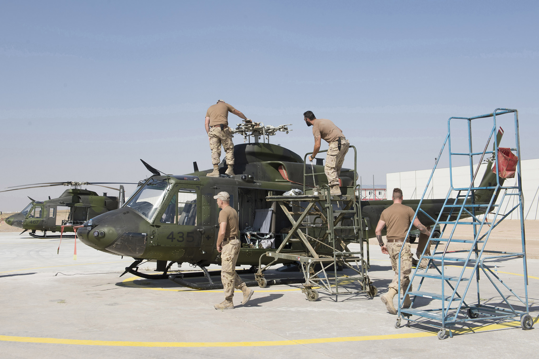 During Operation Impact, Canadian Armed Forces personnel from the Tactical Aviation Detachment assemble and conduct start-up checks on a CH-146 Griffon helicopter in Erbil, Iraq. From the time they enrol, it takes most technicians about three years before they are actively fixing aircraft in the field. PHOTO: DND, KW05-2016-0168-009