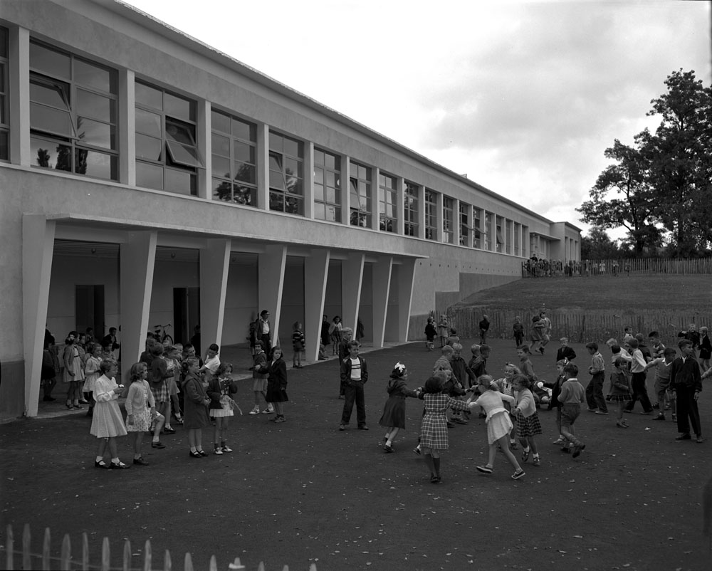 Children play during recess outside the newly-built school for RCAF dependants at Metz, France, on September 28, 1955. PHOTO: LAC MIKAN 4948392