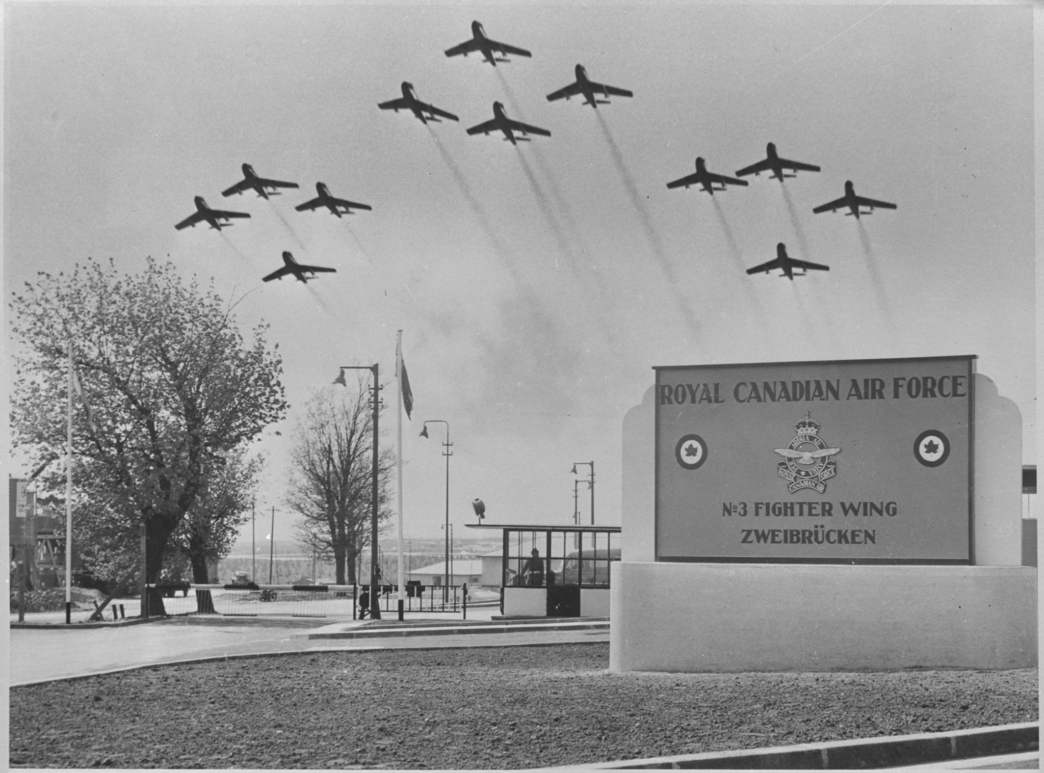 An undated composite photo of 12 Sabre aircraft over the RCAF station at No. 3 (Fighter) Wing in Zweibrucken, Germany. PHOTO: DND Archives, PL-82058