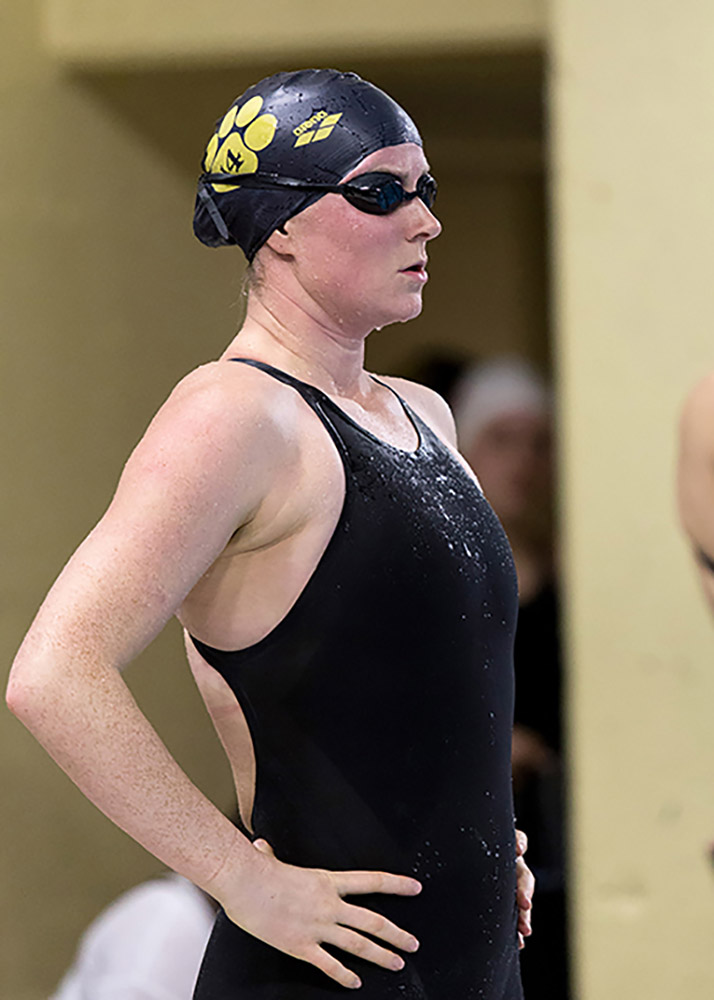 At poolside, RCAF Captain Stephanie Dennis takes a breather during a swimming event. PHOTO: Dalhousie Athletics