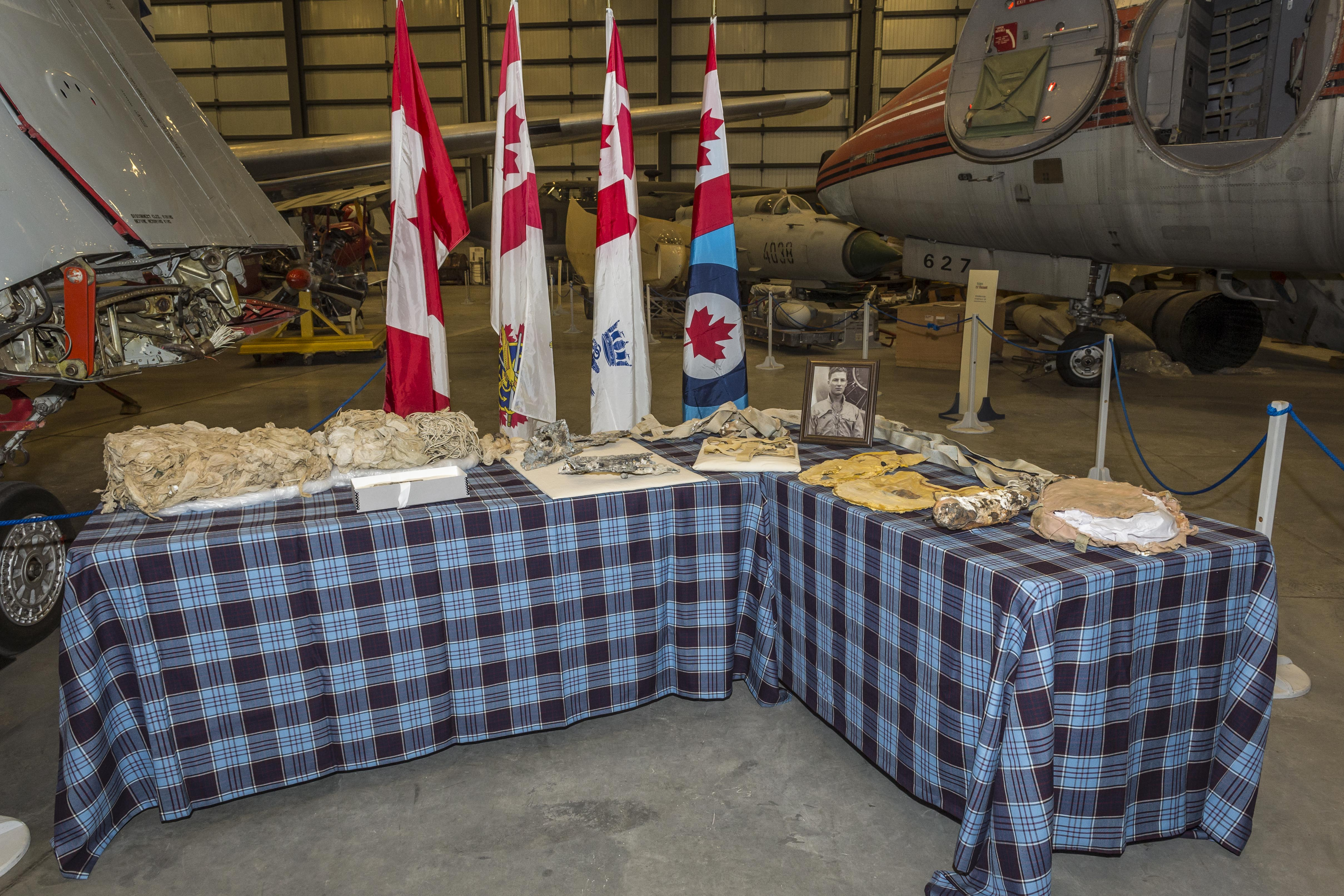 Equipment belonging to Lieutenant Barry Troy and fragments of his Banshee are displayed during the ceremony honouring his memory at the Canada Aviation and Space Museum. PHOTO: Corporal Alana Morin, FA03-2018-0038-025