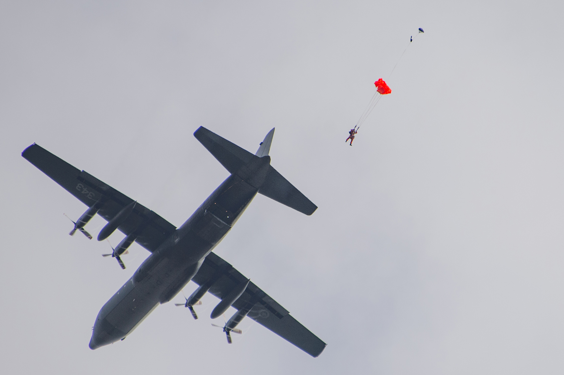 A search and rescue technician jumps from a CC-130 Hercules aircraft to a simulated aircraft crash site at 14 Wing Greenwood, Nova Scotia, on October 5, 2018, during 413 Transport and Rescue Squadron's search and rescue exercise. PHOTO: Corporal Karen Neate, GD10-2018-0688-098