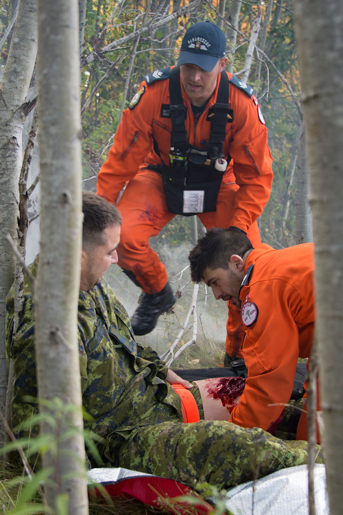 gd10-2018-0688-149-tuskerex-thigh3 Search and rescue technicians Master Corporal Gabriel Ferland (right) and Master Corporal Matthew Sebo tend to Corporal Jean-Luc Germain, a volunteer victim in an aircraft crash scenario during 413 Transport and Rescue Squadron's search and rescue exercise on October 5, 2018, held at 14 Wing Greenwood, Nova Scotia. PHOTO: Corporal Karen Neate, GD10-2018-0688-149