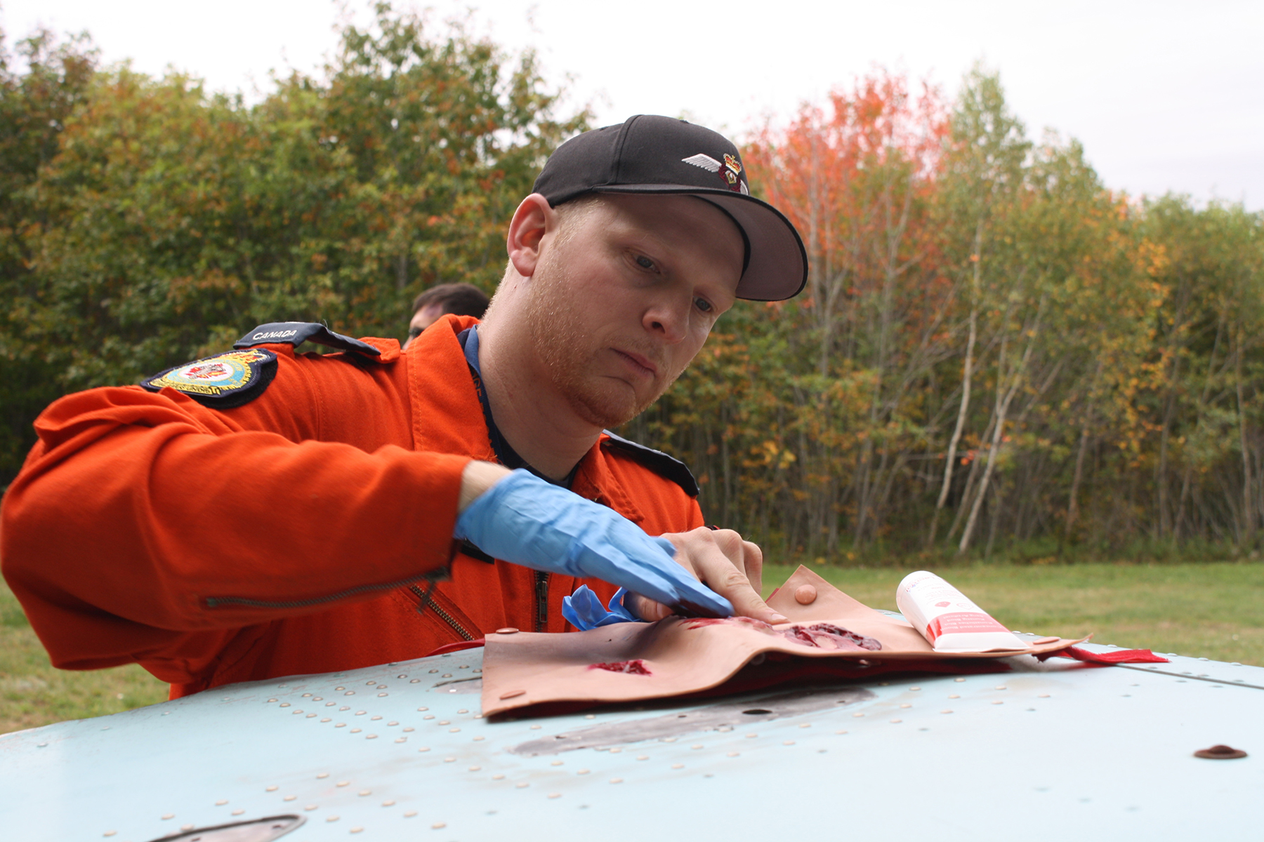 On October 5, 2018, Master Corporal Alexandre Lanoix creates a simulated wound wrap that will be worn by a volunteer victim of a simulated two-aircraft crash during 413 Transport and Rescue Squadron's search and rescue exercise. PHOTO: Sara White