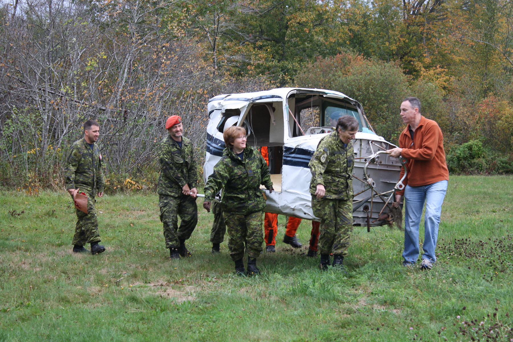 On October 5, 2018, organizers and volunteer victims of 413 Transport and Rescue Squadron's mass casualty exercise, part of the week-long search and rescue exercise, were pressed into service, moving one of two aircraft carcasses into better position for the simulated crash scene. PHOTO: Sara White