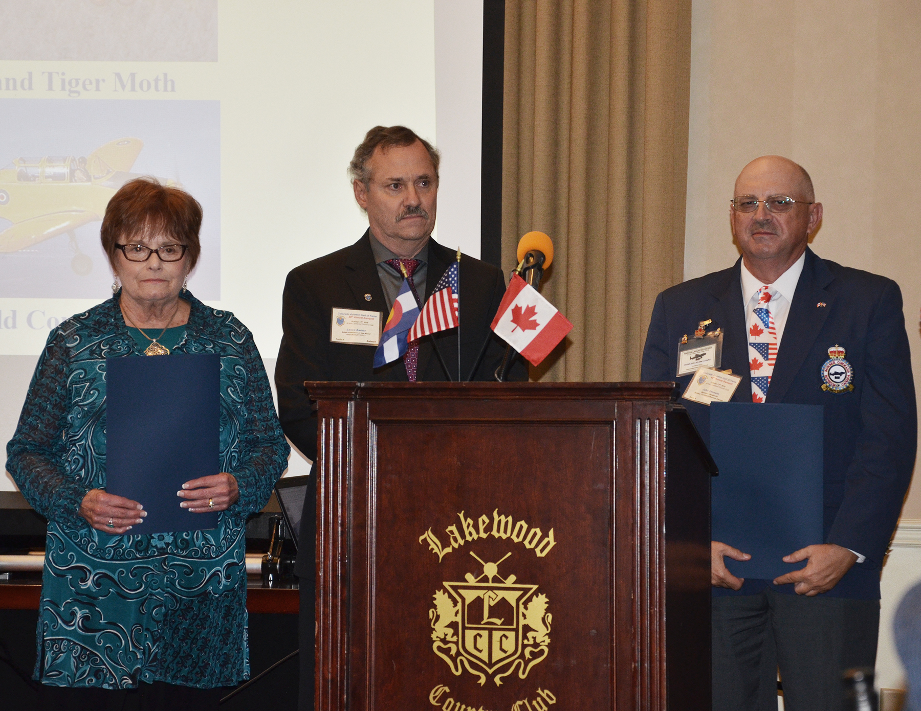 During the October 13, 2018, ceremony, Colorado Aviation Hall of Fame board member Lance Barber is flanked by Marylin Marrs, the daughter of Ralph Hendricks, and Bomber Command Museum of Canada lifetime member John Stemple. PHOTO: Submitted