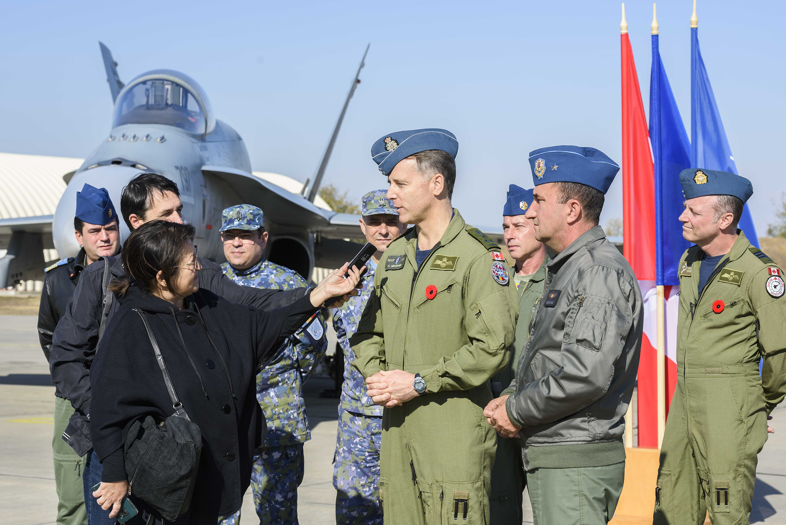 Lieutenant-General Al Meinzinger, commander of the Royal Canadian Air Force, responds to questions from a journalist at Mihail Kogalniceanu in Romania while visiting the fighter detachment deployed on Operation Reassurance on October 27, 2018. Approximately 135 personnel and five CF-188 Hornets are deployed on the operation, participating in NATO enhanced Air Policing to safeguard the integrity of NATO airspace. The RCAF personnel are mainly from 425 Tactical Fighter Squadron, supported by personnel primarily from 2 Air Expeditionary Wing and 3 Wing. All the units are from Bagotville, Quebec. PHOTO: Corporal Dominic Duchesne-Beaulieu, RP20-2018-0044-013