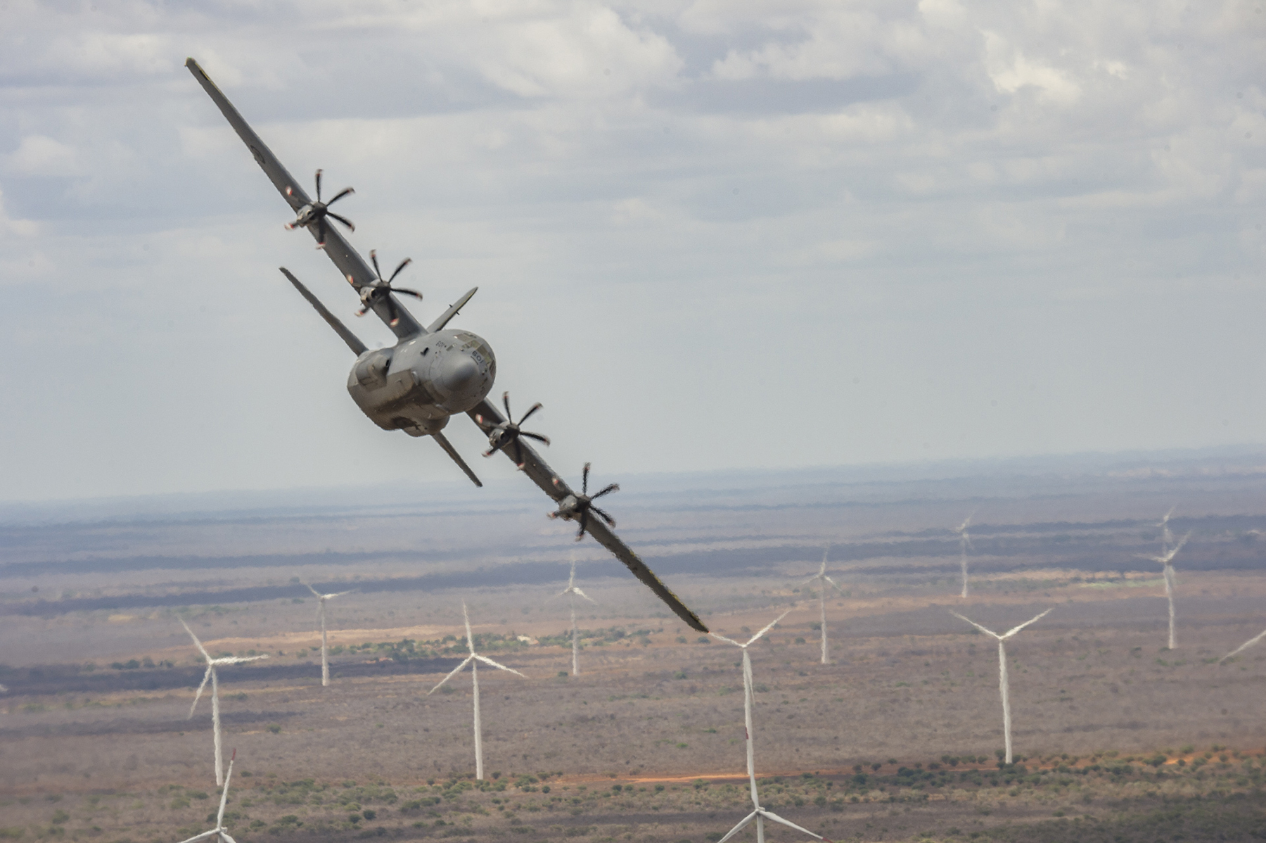 A CC-130J Hercules from 436 Transport Squadron flies over a windfarm near Natal, Brazil during a training flight on CRUZEX 2018 on November 23, 2018. PHOTO: Able Seaman Paul Green