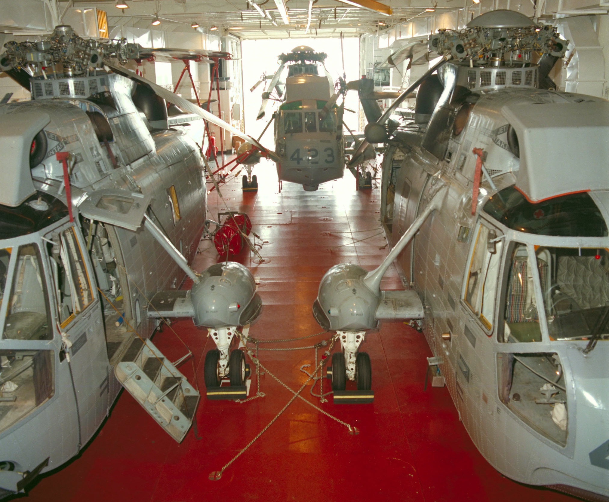 Sea Kings helicopters in HMCS Protecteur's hangar, circa 1990. PHOTO: DND Archives, IHC90-002-8