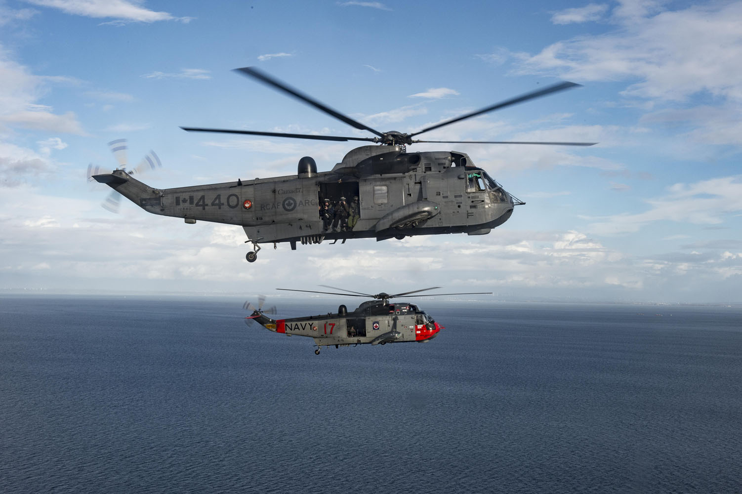 CH-124 Sea King Helicopters from 443 Maritime Helicopter Squadron in Patricia Bay, British Columbia, conduct fly over Vancouver Island on November 27, 2018. PHOTO:  Leading Seaman Laurance Clarke, SW05-2018-0497-027