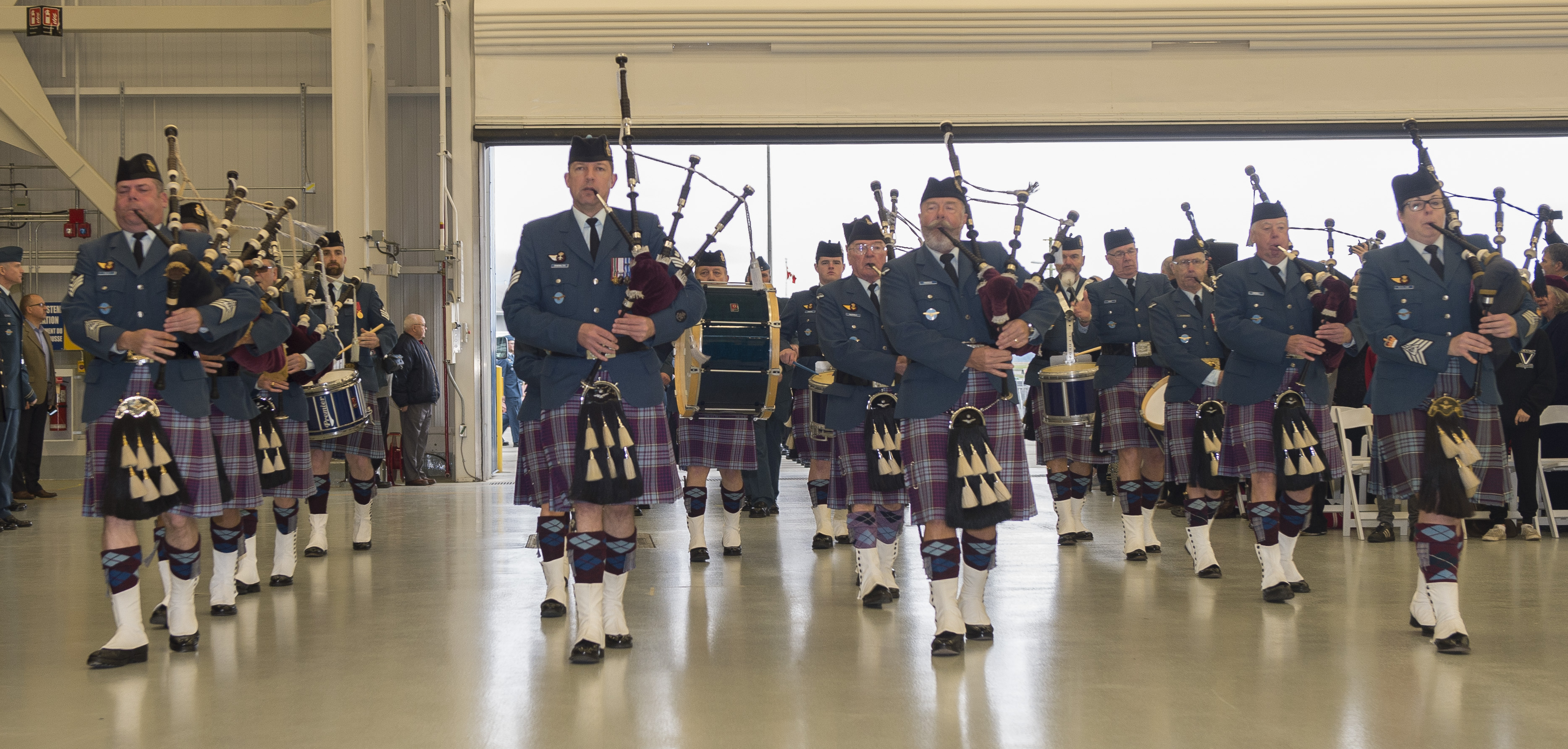 The 12 Wing Combined Pipes and Drums participated in the farewell ceremony for the Sea King helicopter on December 1, 2018. The band comprised members of the 443 Squadron Pipes and Drums, augmented by members of the 12 Wing Pipes and Drums. PHOTO: Leading Seaman Laurance Clarke, SW05-2018-0497-660