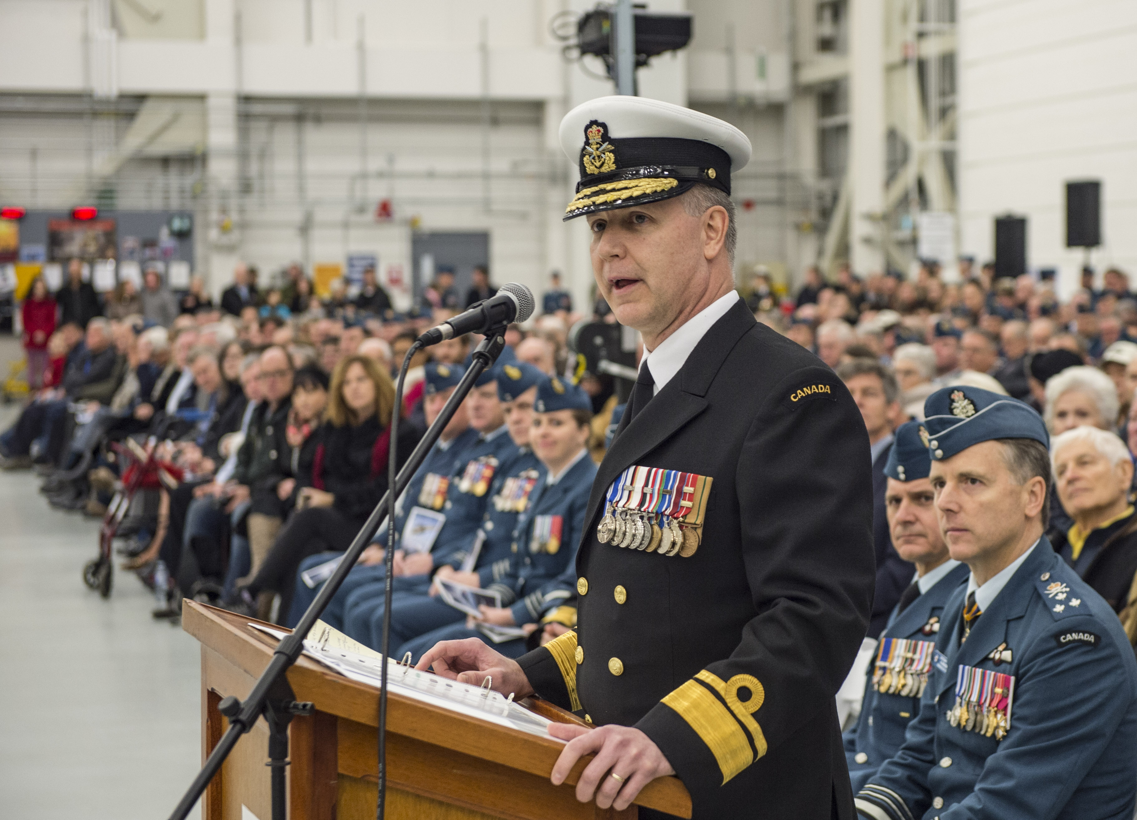 Rear-Admiral Art McDonald, deputy commander of the RCN, addresses aviators, sailors, and guests at the Sea King retirement ceremony on December 1, 2018. PHOTO: Leading Seaman Laurance Clarke, SW05-2018-0497-670