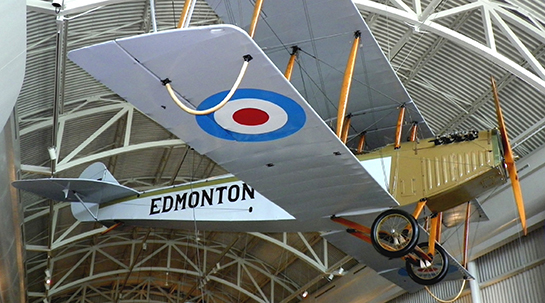 "The 100-year old Curtiss JN-4 ""Canuck"" came to the Royal Alberta Museum from the Reynolds-Alberta Museum at Wetaskiwin, Alberta, where it had been hanging for 20 years, as seen above. PHOTO: John Chalmers"