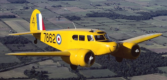 In RCAF wartime training livery, a Cessna Crane is seen in flight as a multi-engine trainer in the British Commonwealth Air Training Plan. This aircraft's home is the Canadian Warplane Heritage Museum. PHOTO: Rick Radell