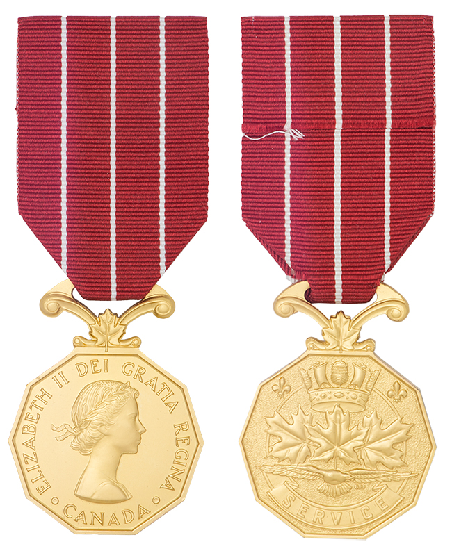 The Canadian Forces' Decoration is awarded to officers and non-commissioned members of the Canadian Armed Forces who have completed 12 years of service. The decoration is awarded to all ranks, who have a good record of conduct. On the left is the obverse (front) of the medal, on the right is the reverse (back) of the medal. IMAGE: DND/CAF