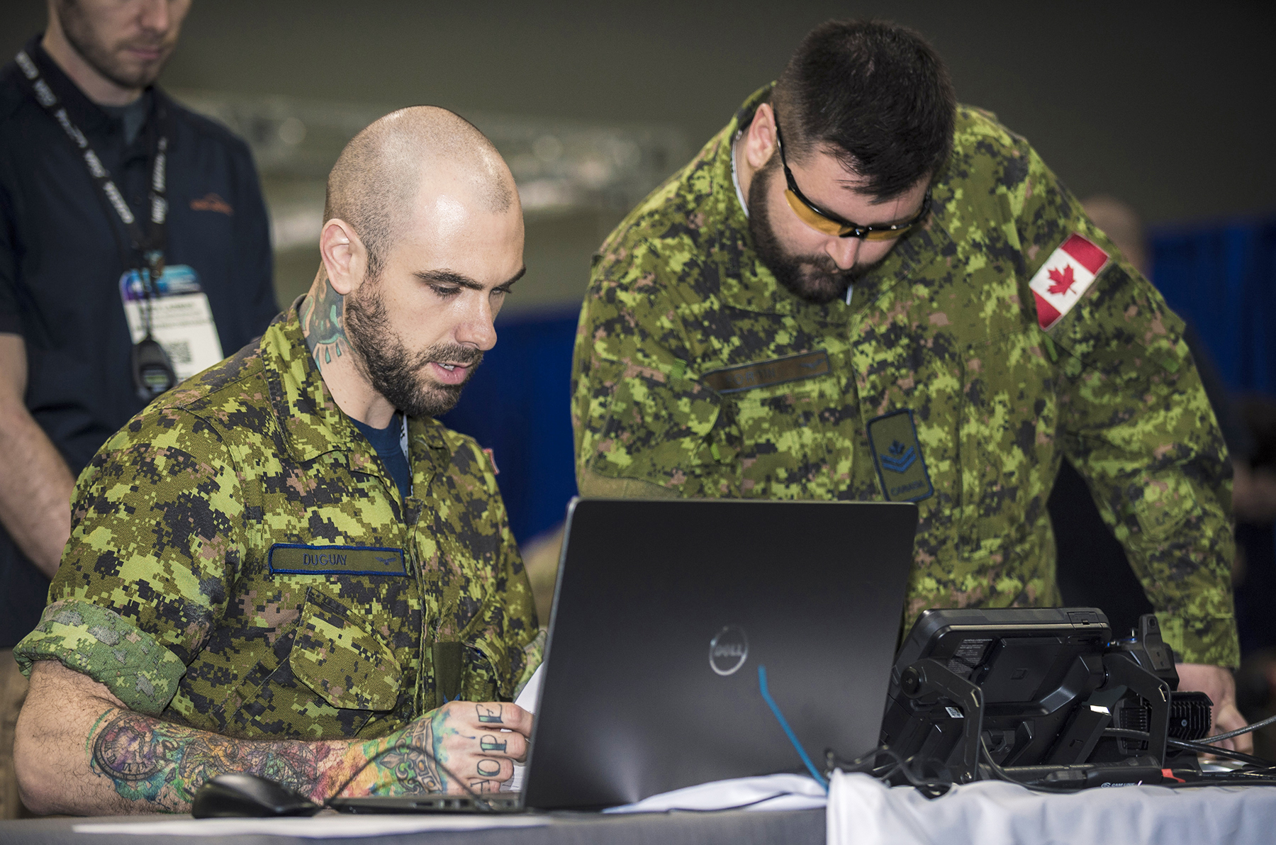 Corporal Marc André Duguay (left), AVS, from 424 Transport and Rescue Squadron, Trenton, with Master Corporal Chris Fortin, AVS, from 418 Transport and Rescue Squadron, check data during the Aerospace Maintenance Competition. Both were members of the RCAF SAR Maintenance Team. PHOTO: RCAF