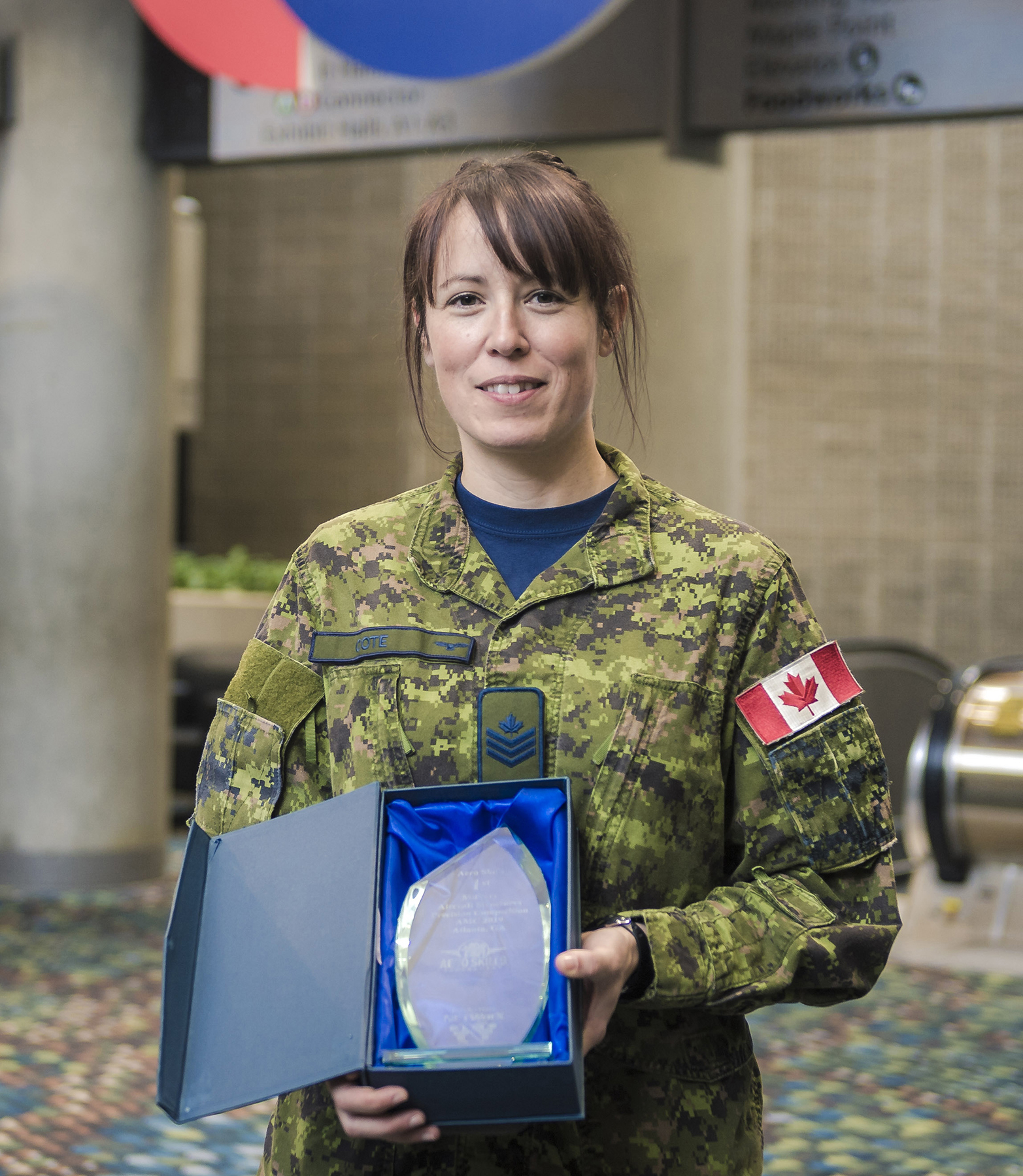 "Sergeant Amélie Côté, from 10 Field Technical Training Squadron, and a member of the 4 Wing Team, won the award for best time on task number three: aircraft technologies group sheet metal accuracy. This task required competitors to test their ""sheet metal/structures skill and accuracy for locating a part, laying out/marking holes and shims, drilling and dragging holes, as required, in aluminum parts"".  PHOTO: RCAF"