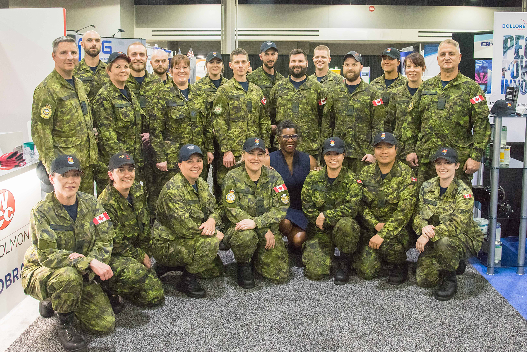 Nadia Theodore (kneeling, centre), Consul General of Canada in Atlanta, meets with RCAF air maintenance technicians during the Aerospace Maintenance Competition held in Atlanta, Georgia, April 8-11, 2019. PHOTO: RCAF