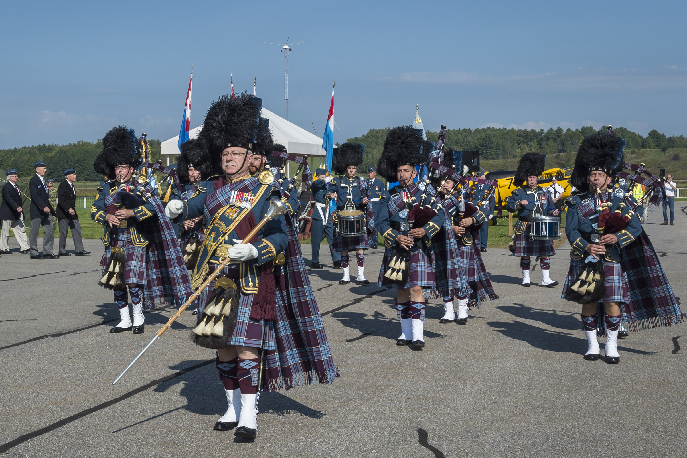 Military personnel playing bagpipes.