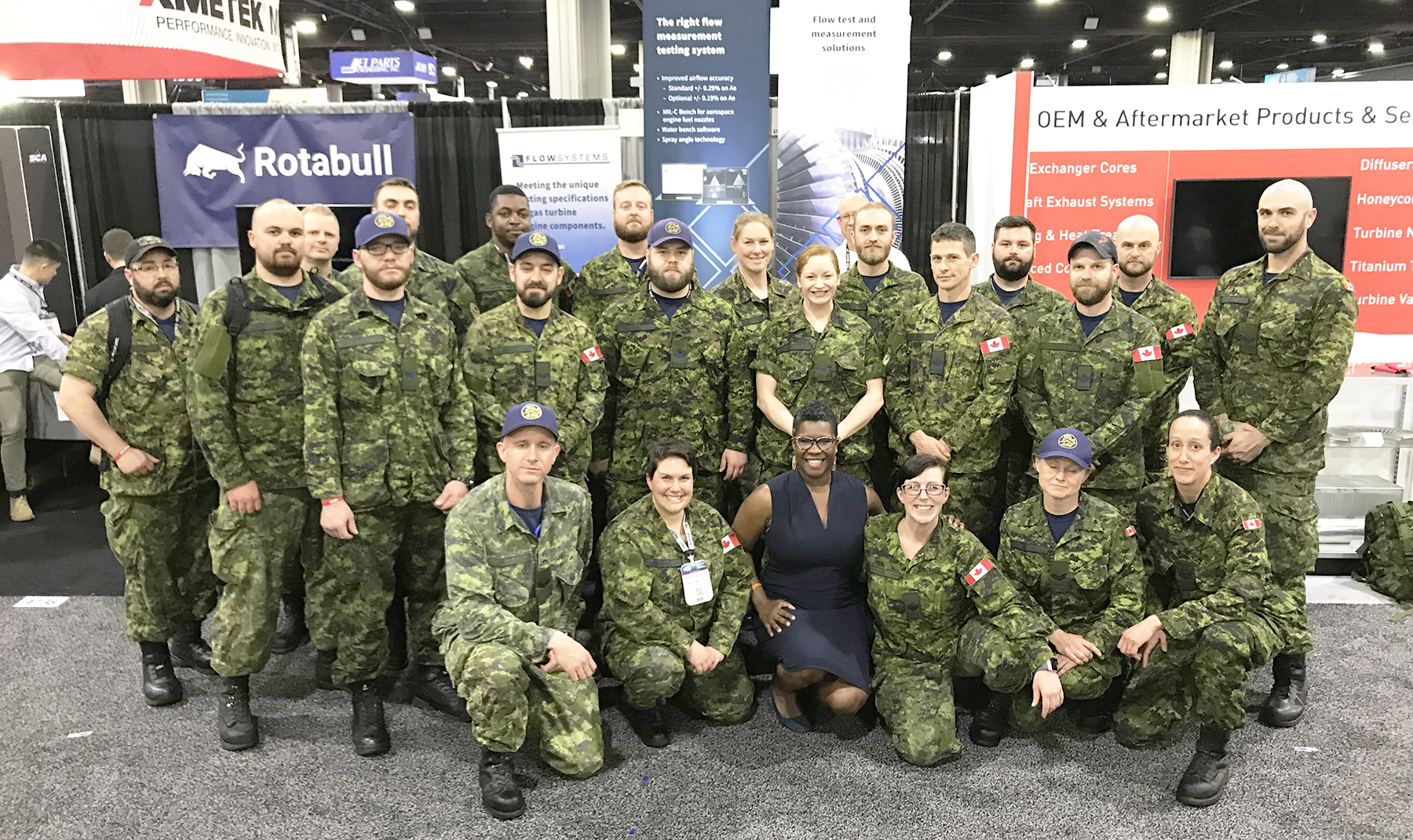 Nadia Theodore (kneeling, centre), Consul General of Canada in Atlanta, met with RCAF air maintenance technicians during the Aerospace Maintenance Competition held in Atlanta, Georgia, April 8-11, 2019. PHOTO: RCAF
