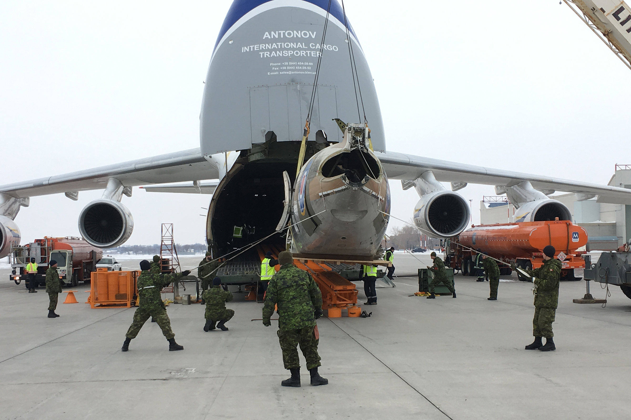 "The fuselage of ""Spirit of Ostra Brama"" is loaded into an Antonov cargo aircraft for shipment from 17 Wing Winnipeg to Warsaw, Poland. PHOTO: Submitted"