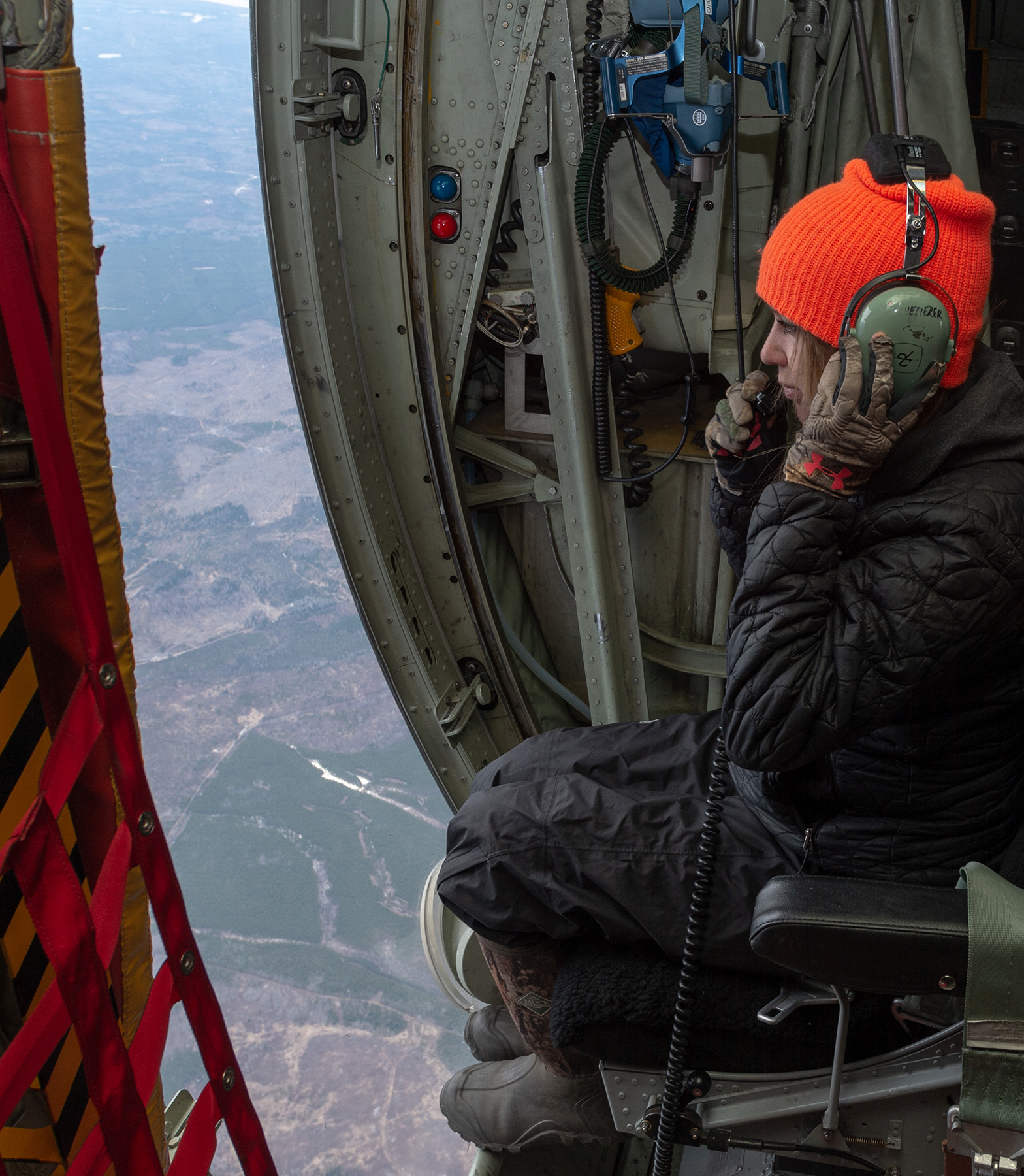 Civil Air Search and Rescue Association (CASARA) member Bobbi Fisher searches for a simulated crash site from a CC-130 Hercules aircraft on May 8, 2019, during Chinthex 2019, held near Thunder Bay, Ontario. PHOTO: Corporal Bryce Cooper, WG2019-0191-101