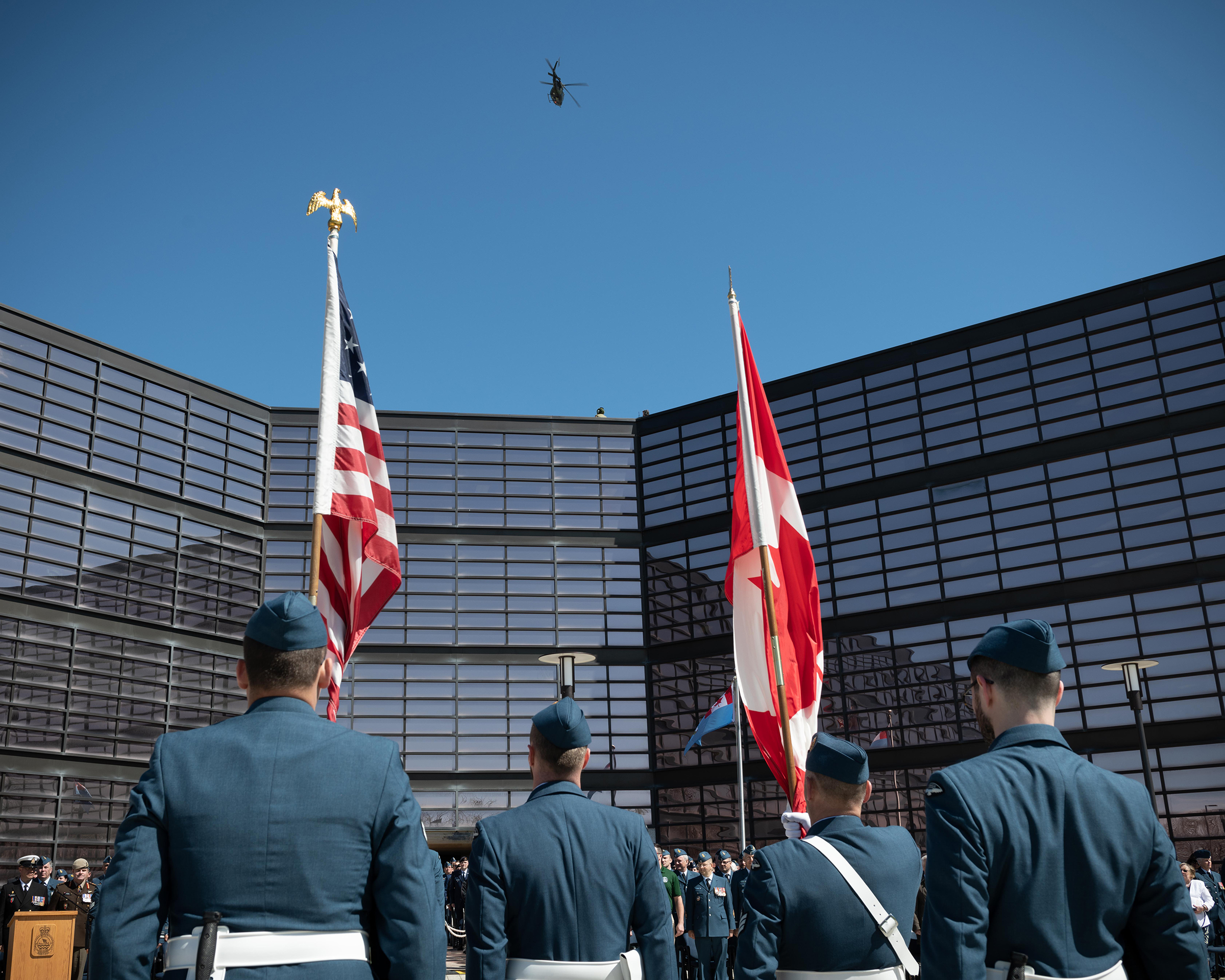 A CH-146 Griffon helicopter from 408 Tactical Helicopter Squadron, based in Edmonton, Alberta, flies over 1 Canadian Air Division headquarters during the change of command ceremony for 1 Canadian Air Division, Canadian NORAD Region and the Joint Force Air Component, held in Winnipeg, Manitoba, on May 16, 2019. PHOTO: Aviator Tanner Musseau-Seaward, WG2019-0213-003