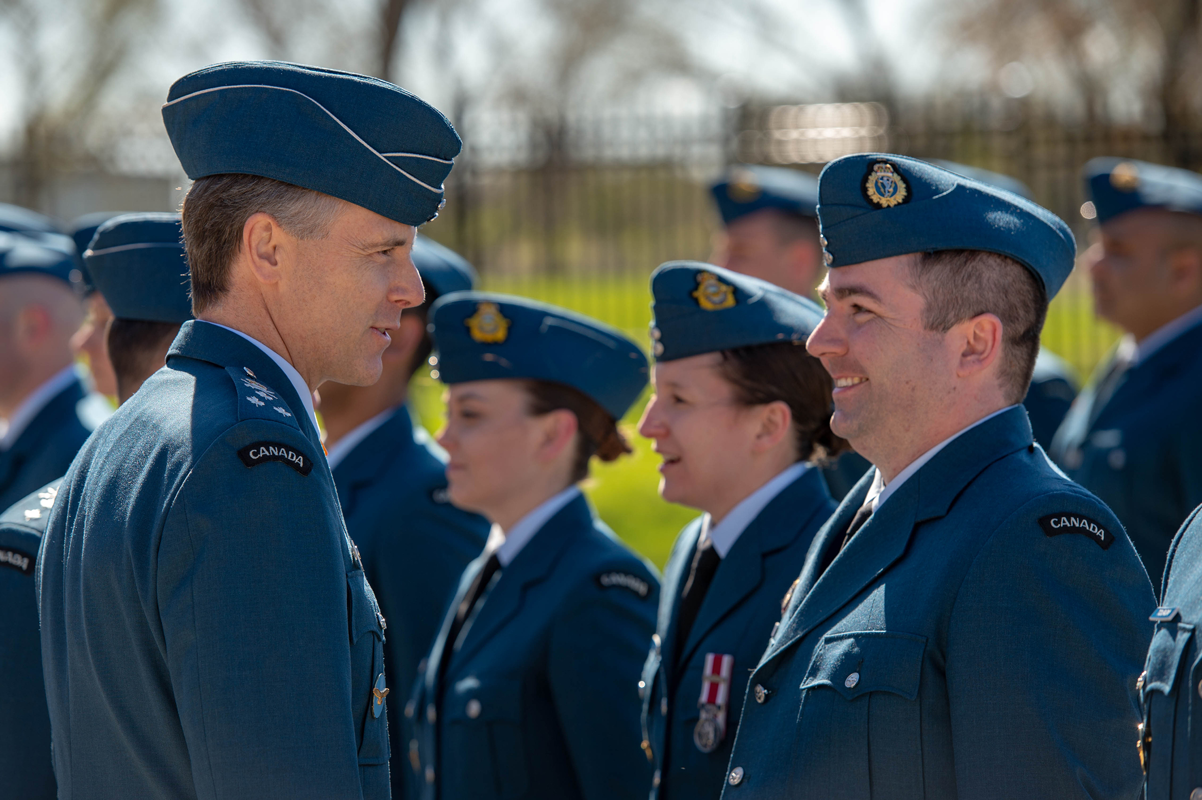 Lieutenant-General Al Meinzinger, commander of the Royal Canadian Air Force, speaks with a member of the RCAF as he reviews the parade during the change of command ceremony for 1 Canadian Air Division, Canadian NORAD Region and the Joint Force Air Component held May 16, 2019, at 1 CAD headquarters in Winnipeg, Manitoba. PHOTO: Corporal Bryce Cooper, WG2019-0214-021