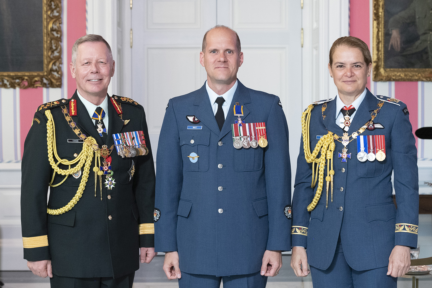 Master Warrant Officer Duane Lewis May, M.M.M., C.D. (centre) stands with Governor-General Julie Payette and Chief of the Defence Staff General Jonathan Vance after receiving the Member insignia of the Order of Military Merit from the Governor General. PHOTO: Sergeant Johanie Maheu, Rideau Hall, © OSGG, GG0505-2019-0118-046