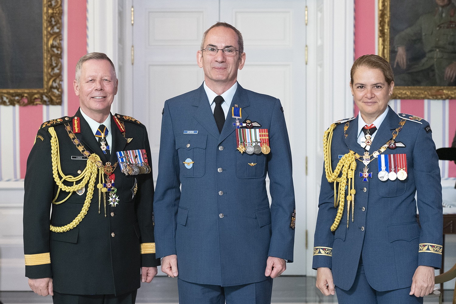 Chief Warrant Officer David Basil Myers, M.M.M., C.D. (centre) stands with Governor-General Julie Payette and Chief of the Defence Staff General Jonathan Vance after receiving the Member insignia of the Order of Military Merit from the Governor General. PHOTO: Sergeant Johanie Maheu, GG05-2019-0118-050