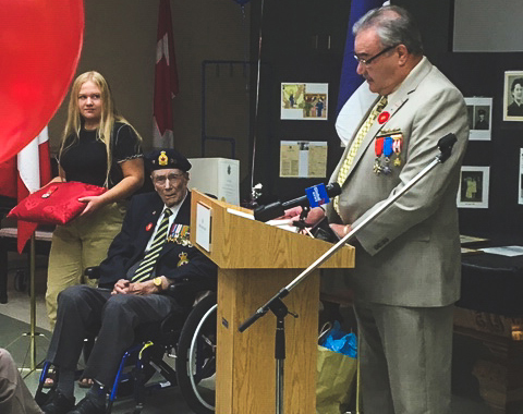 Mr. Bruno Burnichon of the French Consulate in Winnipeg, Manitoba, speaks to the audience before presenting France's Legion of Honour, the nation's highest distinction for merit, to Corporal (retired) Ian Wilson on June 15, 2019. Corporal Wilson served with the Royal Canadian Air Force's 411 (Fighter) Squadron during the Second World War and arrived in France with the squadron three days after D-Day, June 6, 1944. PHOTO: Nicole LaTourelle, Deer Lodge Centre Foundation