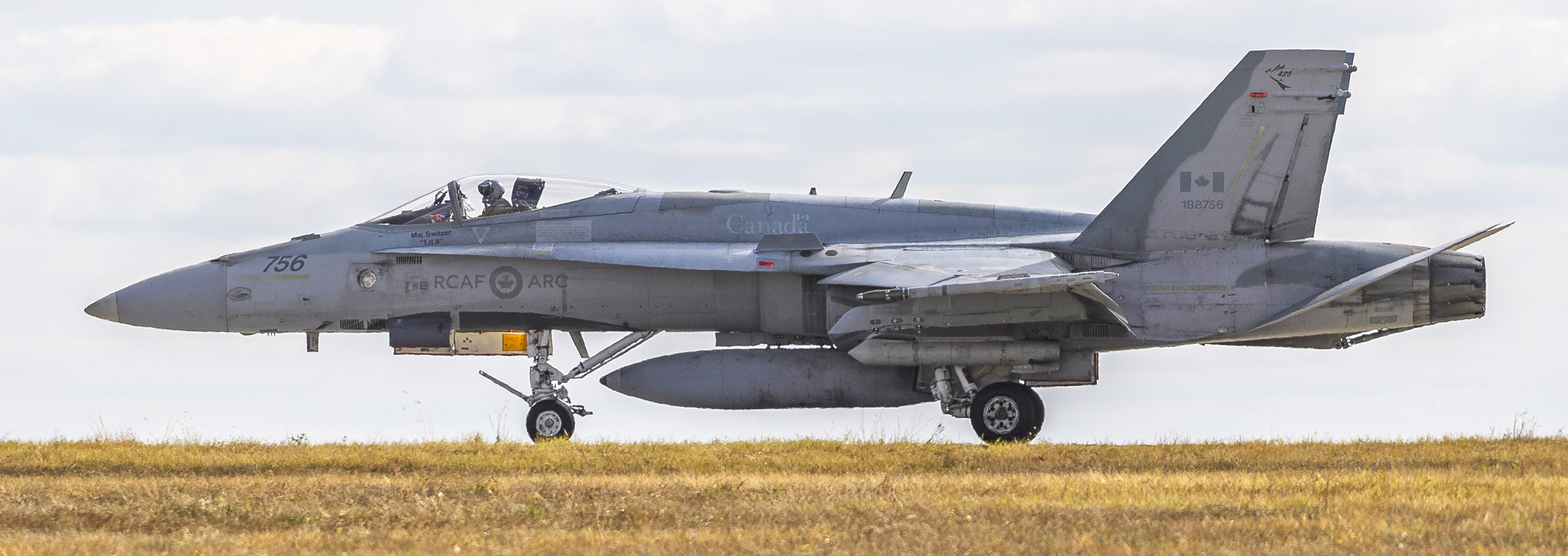 This CF-188 Hornet displays its registration or tail number—consisting of three digits (188) representing the type of aircraft (Hornet) plus three digits (756) identifying this particular airframe—on its tail fin. The 756 is also painted on the Hornet's nose. It is taxiing on the runway at Mihail Kogalniceanu Air Base in Romania on October 6, 2018, during Operation Reassurance. PHOTO: Corporal Dominic Duchesne-Beaulieu, RP20-2018-0034-002